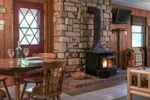 dining table and wood burning stove - romantic accommodations near Starved Rock