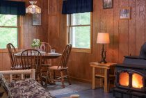 Commanche Cabin dining table and wood burning stove