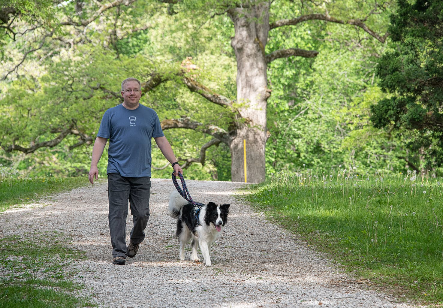 man walking dog at our lodging near Starved Rock State Park