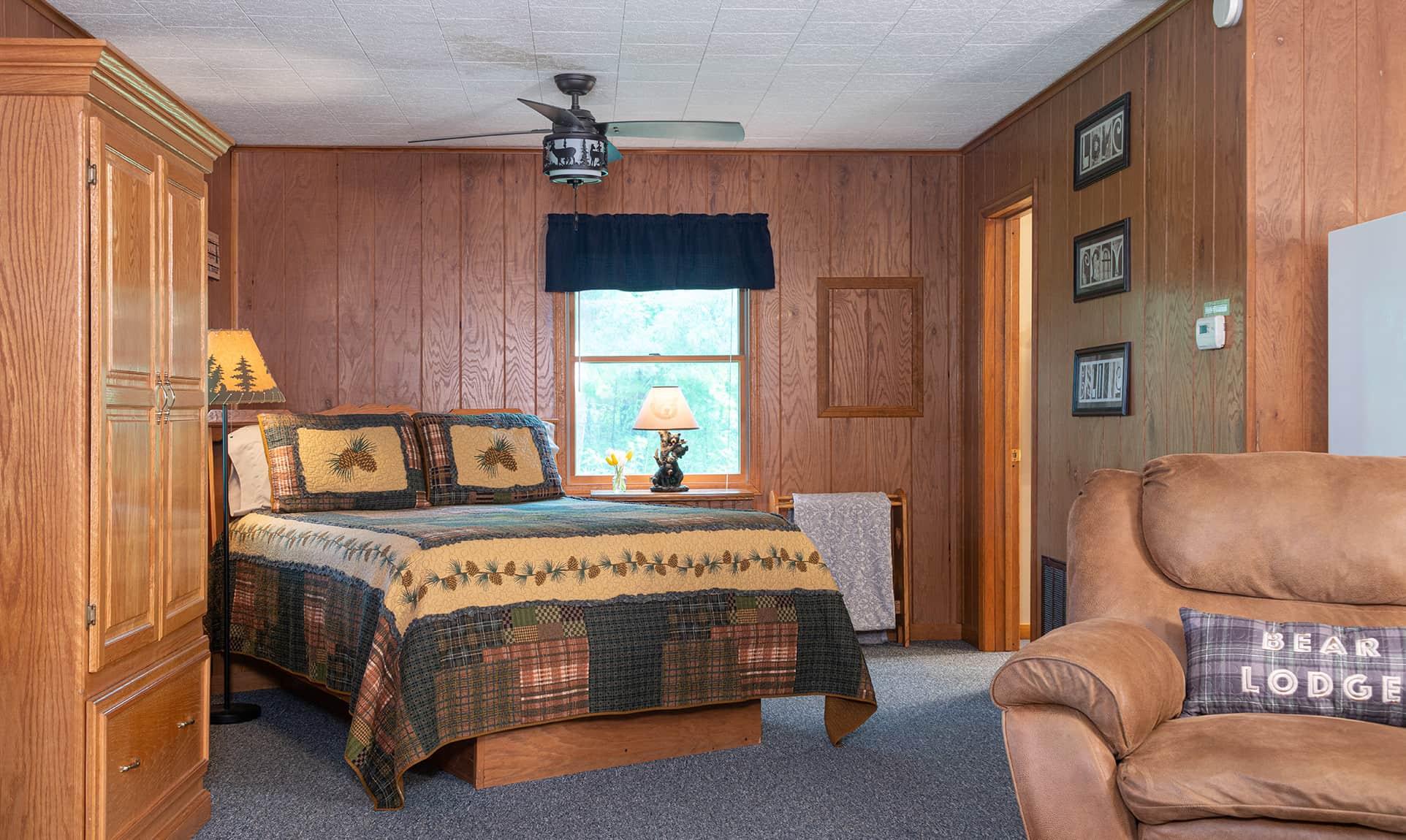 Queen bed in a rustic cabin getaway near Chicago