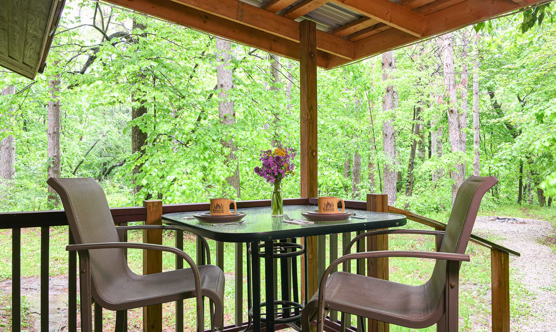 outdoor deck for dining in a rustic cabin getaway near Chicago