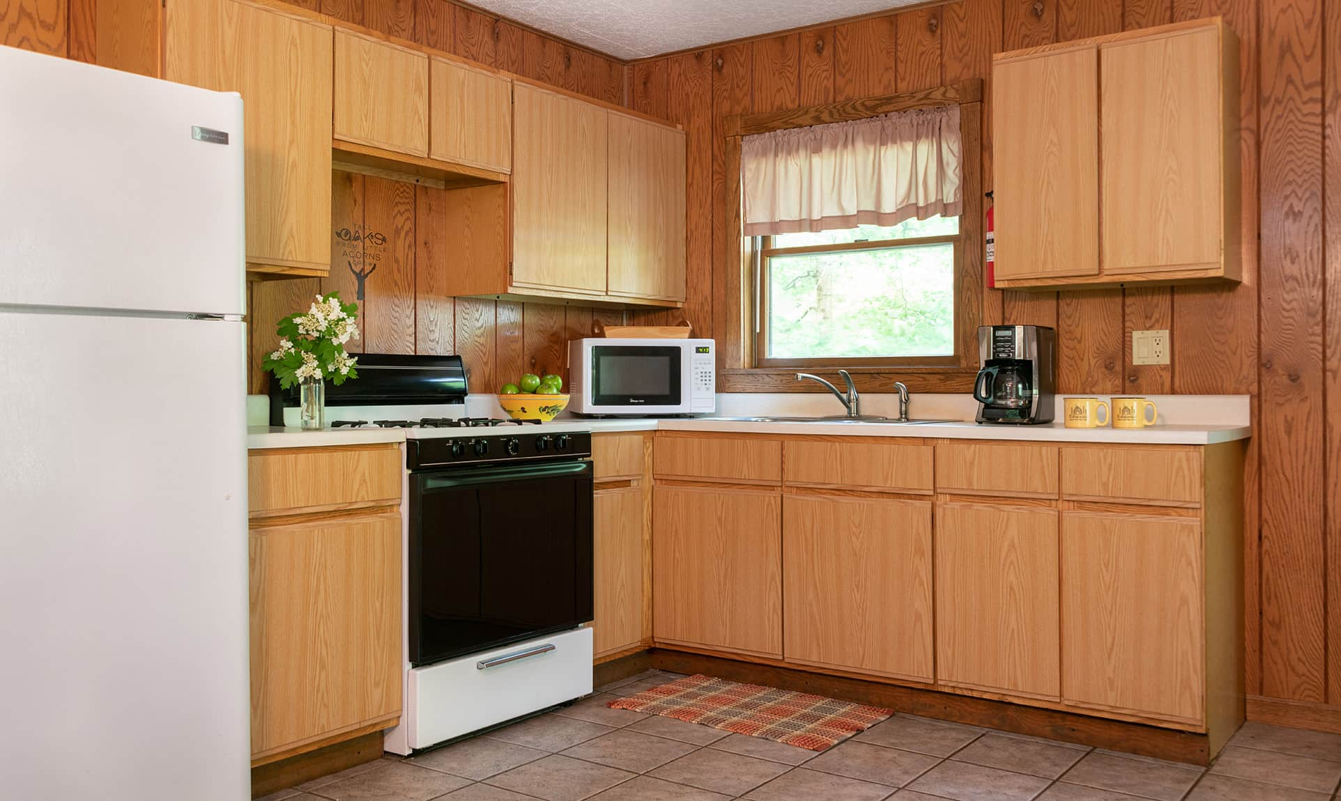 Full kitchen in a romantic Illinois cabin near Starved Rock