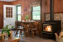 dining table and wood burning stove in a romantic Illinois cabin near Starved Rock