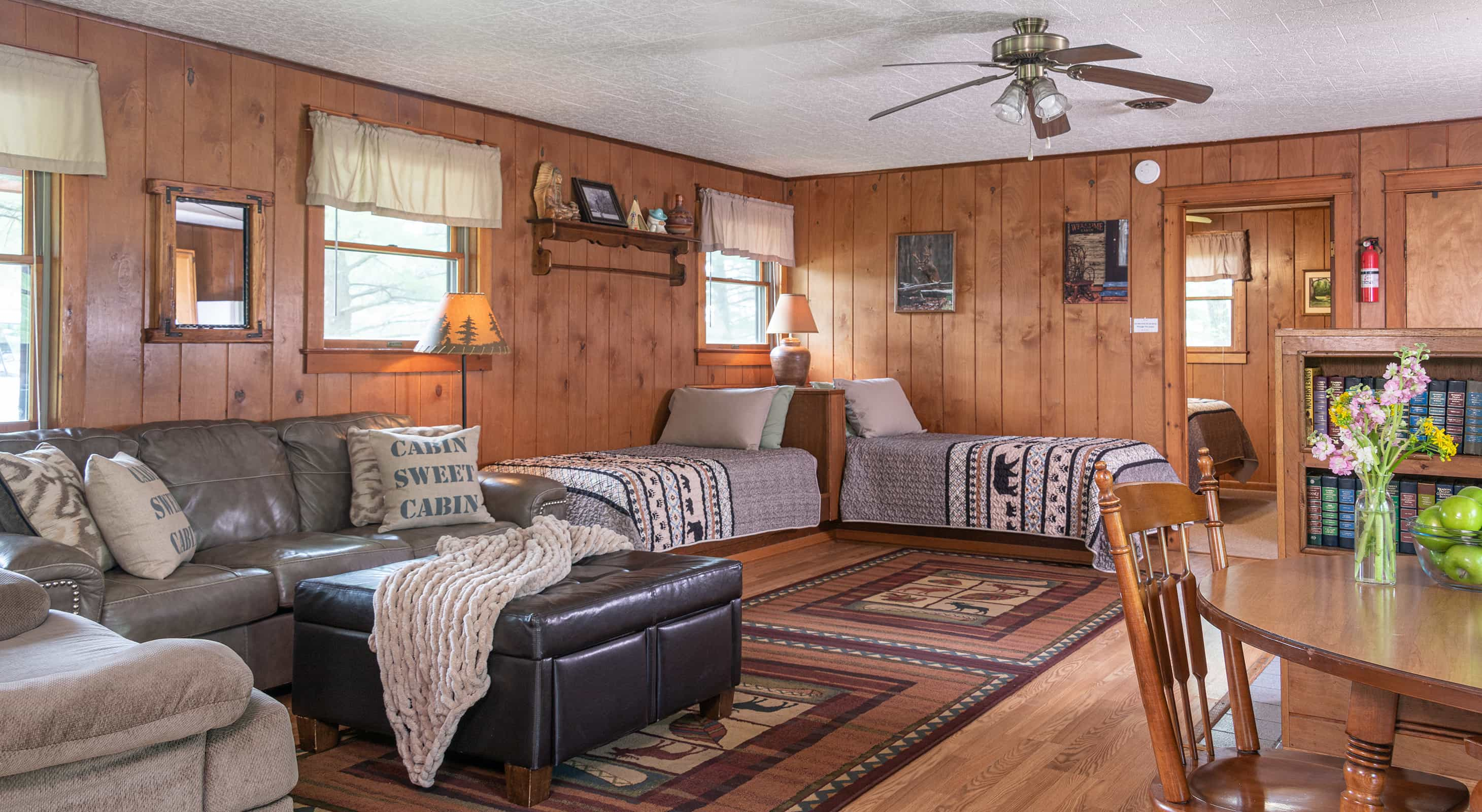 beds and couch in the Trading Post Cabin
