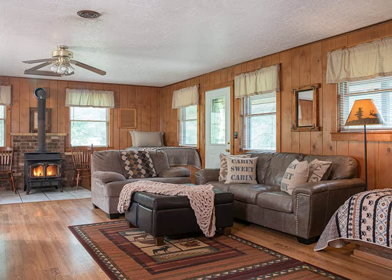 Trading Post Cabin couches and wood burning stove