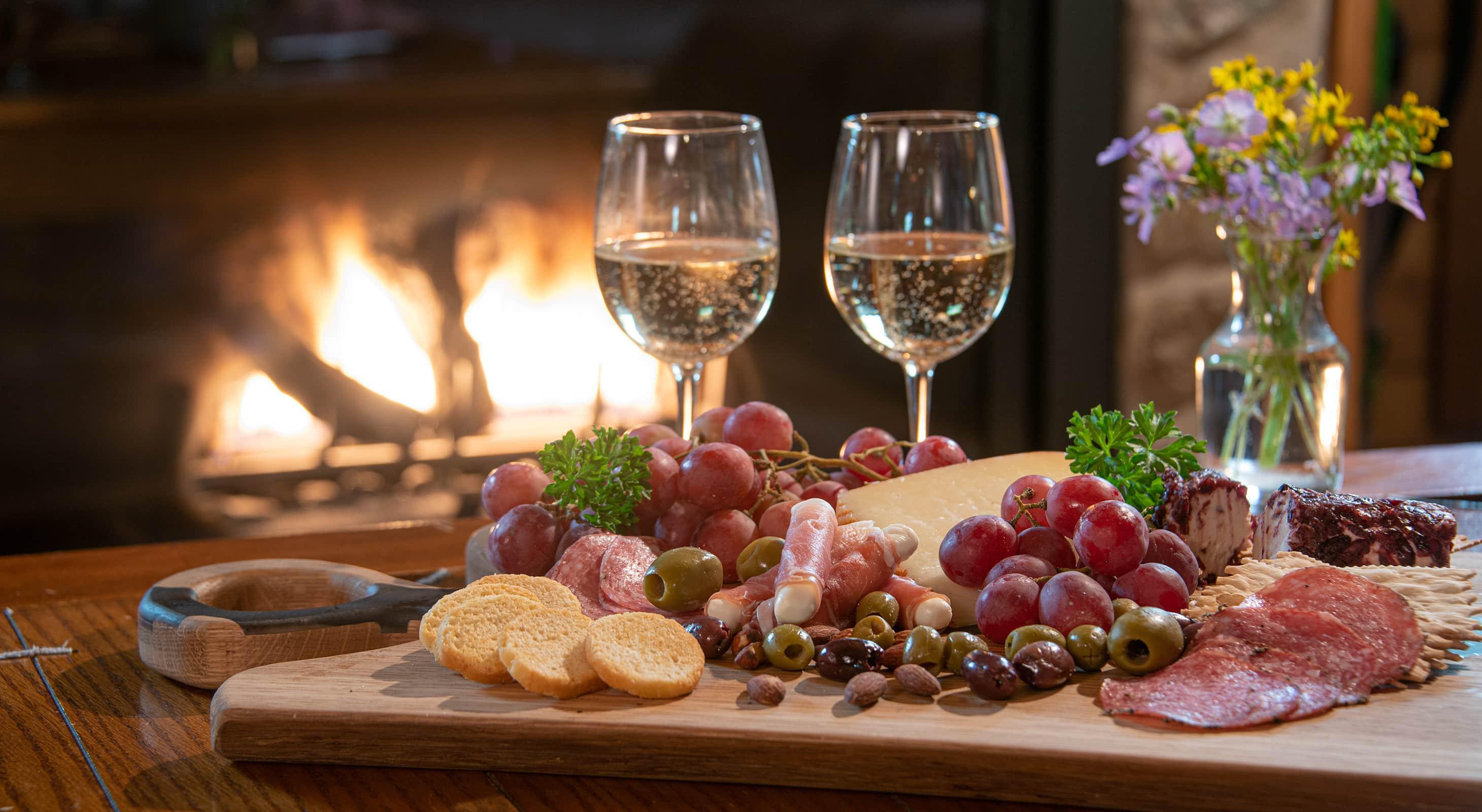 charcuterie board and wine for a romantic Illinois cabin getaway