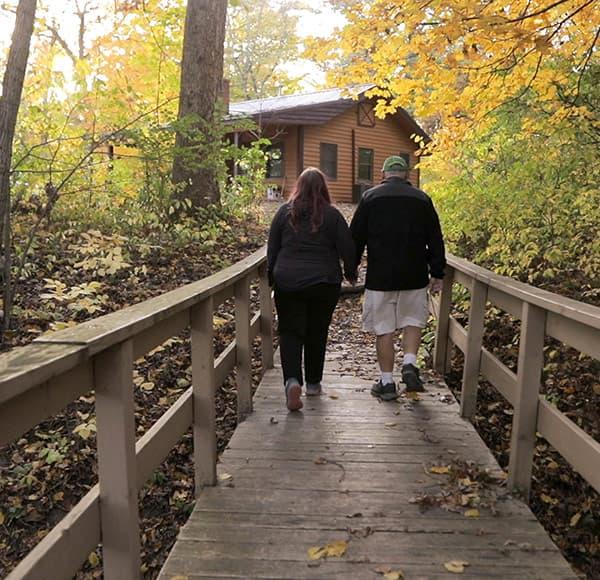 couple on a bridge during a romantic Illinois cabin getaway