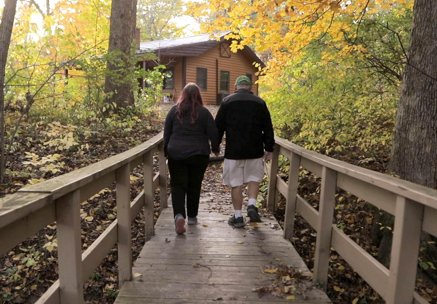 couple walking to their Illinois honeymoon cabin