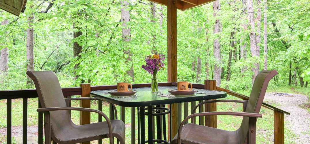 table on the deck of the Pines Cabin