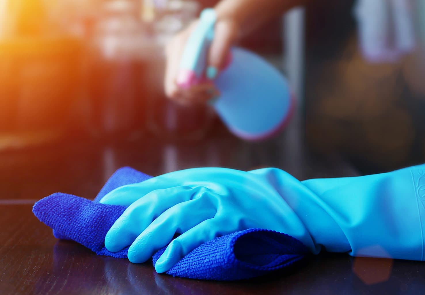 hands in blue gloves cleaning