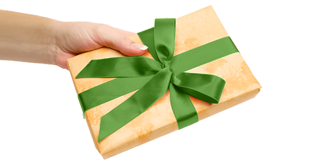 hand holding a gift box wrapped in gold with bow