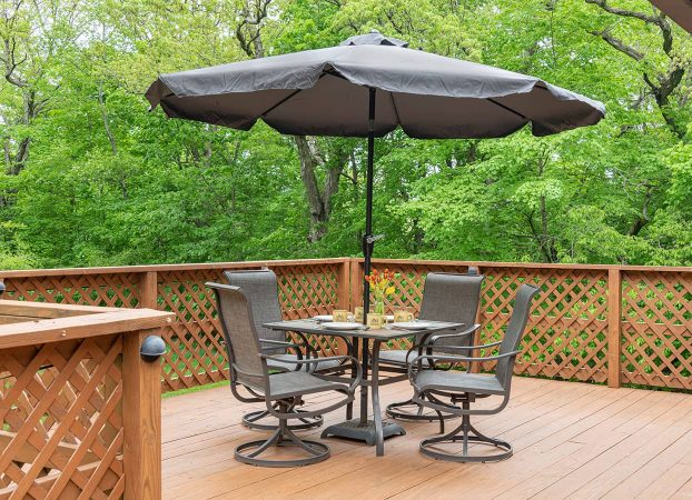 Outdoor dining table with four chairs on Jack's Deluxe Porch