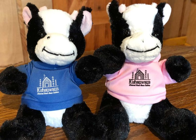 Plush cow with Kishauwau logo in pink or blue