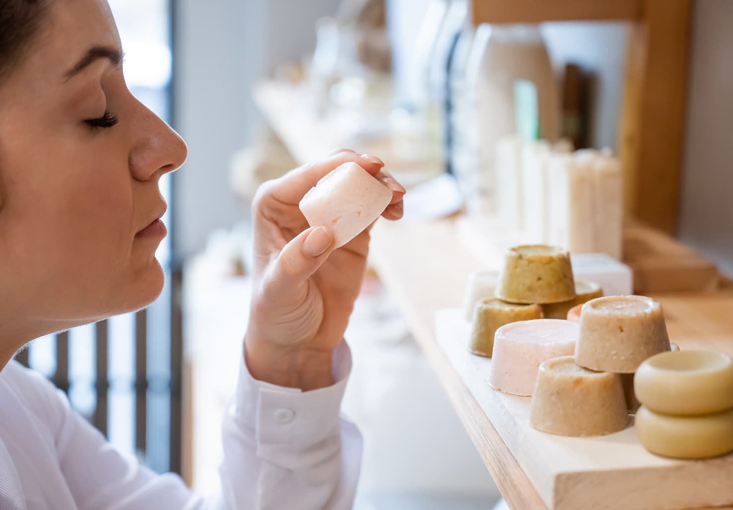 woman smelling soap in spa