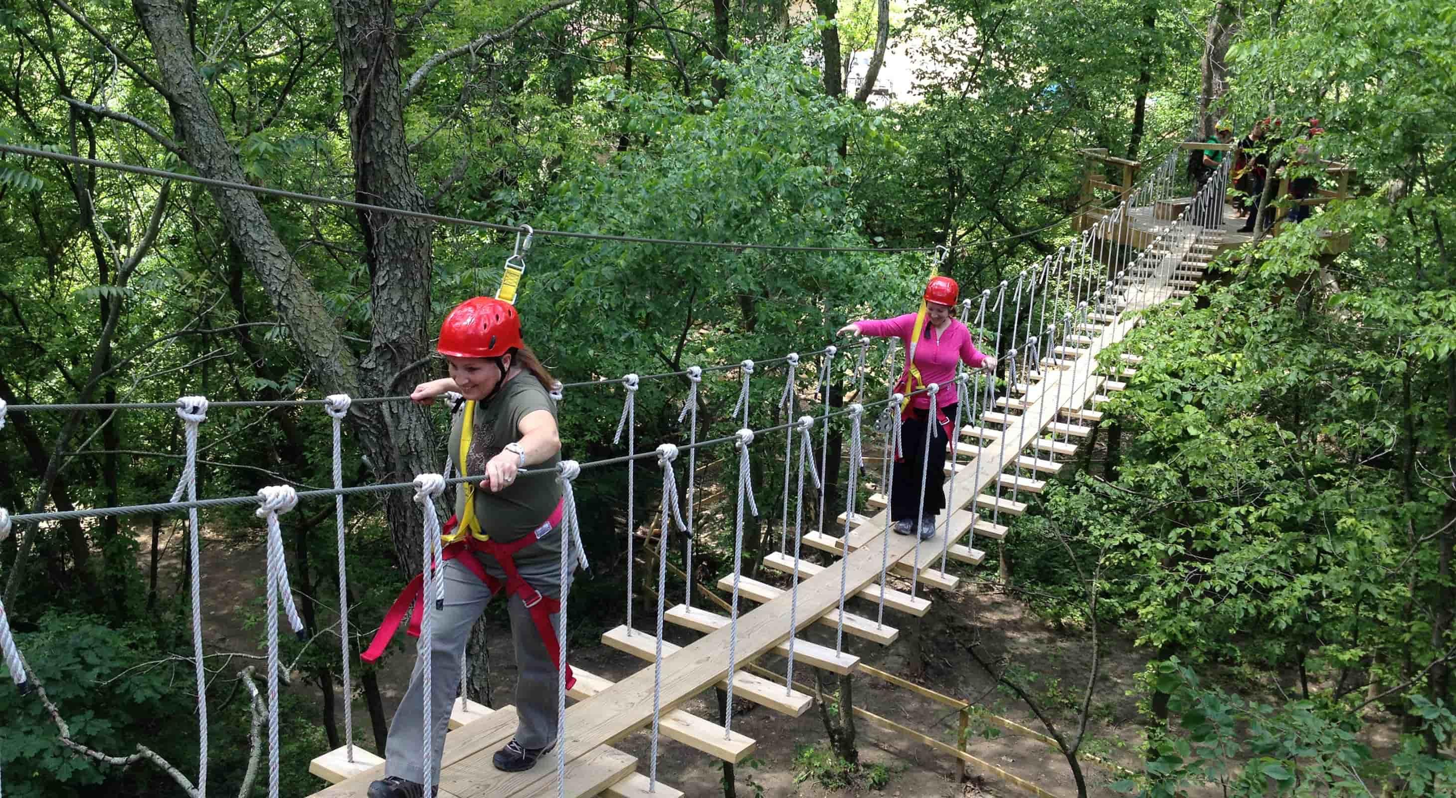 Two women on ziplining bridge at Zip Chicago